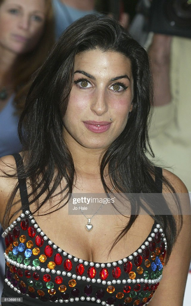 Amy Winehouse arrives at the annual 'Nationwide Mercury Music Prize' at the Grosvenor House on September 7, 2004 in London. Making the 12-album shortlist this year are Basement Jaxx (Kish Kash), Belle & Sebastian (Dear Catastrophe Waitress), Franz Ferdinand (Franz Ferdinand), Jamelia (Thank You), Keane (Hopes and Fears), Snow Patrol (Final Straw), Joss Stone (The Soul Sessions, The Streets (A Grand Don't Come For Free), Ty (Upwards), Amy Winehouse (Frank), Robert Wyatt (Cuckooland) and The Zutons (Who Killed The Zutons).
