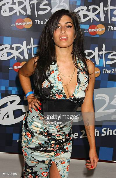 Amy Winehouse arrives for the 25th Anniversary BRIT Awards 2005 at Earl's Court February 9 2005 in London England