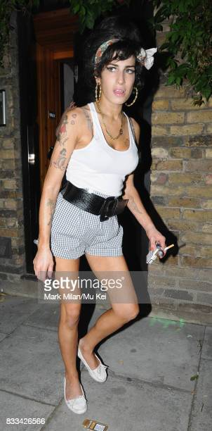 Amy Winehouse hitches a ride with strangers after meeting some friends outside her house in Camden on July 01 2008 in London England