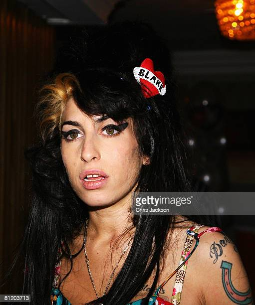 Amy Winehouse looks on during the 53rd Ivor Novello Awards after she won Best Song Musically and Lyrically at the Dorchester Hotel on May 22 2008 in...