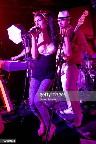 Amy Winehouse makes a surprise appearance as she performs with Mark Ronson at the 100 Club on July 6 2010 in London England