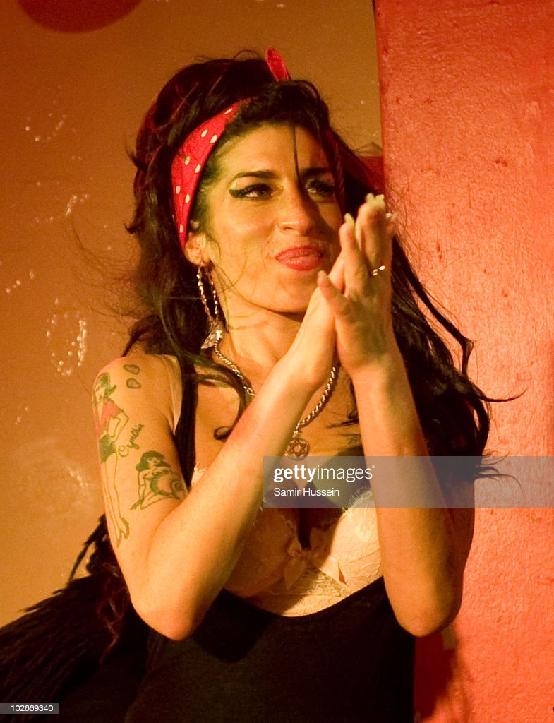 Amy Winehouse makes a surprise appearance with Mark Ronson at the 100 Club on July 6, 2010 in London, England.