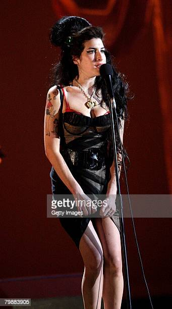 Amy Winehouse performs on stage at the BRIT Awards 2008 at Earls Court 1 on February 20, 2008 in London, England.