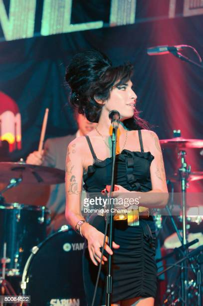 Amy Winehouse performs on stage at the Fendi Paris Store Reopening at Avenue Montaigne on February 29 2008 in Paris France