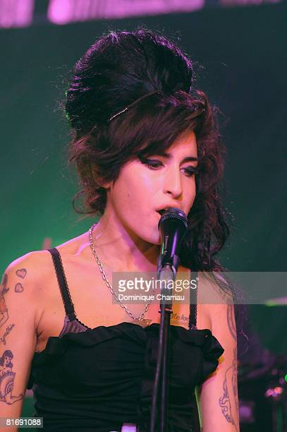 Amy Winehouse Performs on stage the Fendi Paris store reopening at Avenue Montaigne on February 29 2008 Paris France