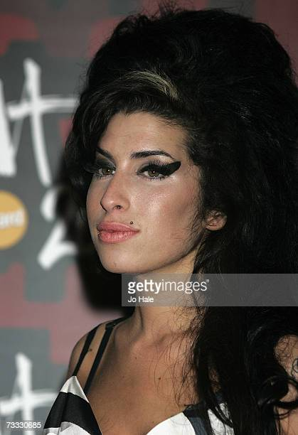 Amy Winehouse poses in the awards room after winning the award for best Female Solo Artist at the BRIT Awards 2007 in association with MasterCard at...