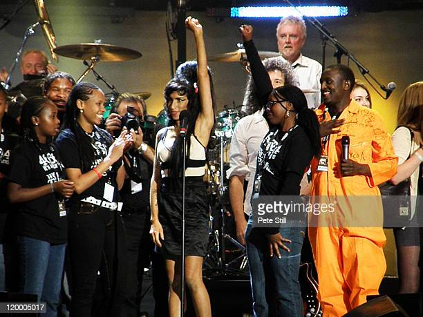 Amy Winehouse salutes the crowd while on stage during the finale of the 46664 concert in honour of Nelson Mandela's 90th birthday in Hyde Park London...