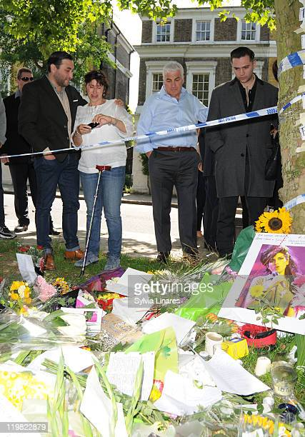 Amy Winehouse's brother Alex Winehouse mother Janis Winehouse father Mitch Winehouse and ex boyfriend Reg Traviss are seen looking at floral tributes...
