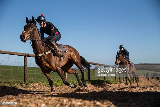 Amy Winter riding Kahaleesi leads Kate Tracey riding Sausalito Sunrise during a workout on the wood chip gallop at Sandhill Racing Stables on March...