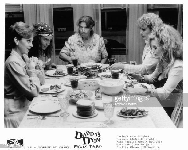 Amy Wright Judge Reinhold Molly McClure Tess Harper and Beverly D'Angelo enjoy dinner together in a scene from the film 'Daddy's Dyin' Who's Got The...