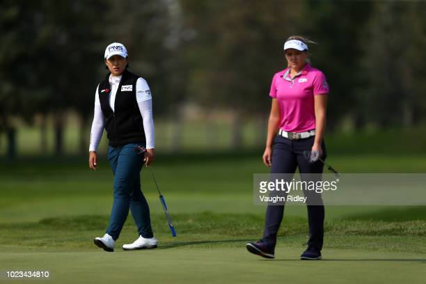 Amy Yang of Korea and Brooke Henderson of Canada walk onto the 16th green during the third round of the CP Womens Open at the Wascana Country Club on...