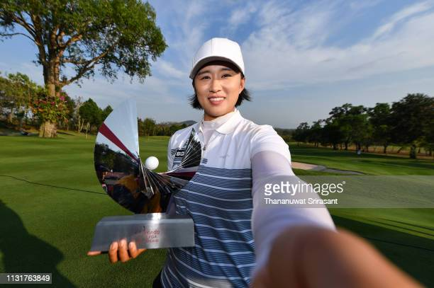 Amy Yang of Republic of Korea imitates taking a selfie photo with her trophy after winning the Honda LPGA Thailand at the Siam Country Club Pattaya...