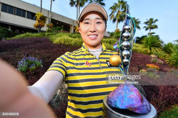 Amy Yang of Republic of Korea imitates taking a selfie photo with her trophy after winning the Honda LPGA Thailand at Siam Country Club on February...