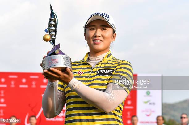 Amy Yang of Republic of Korea poses with the trophy on the 18th green after winning the Honda LPGA Thailand at Siam Country Club on February 26 2017...