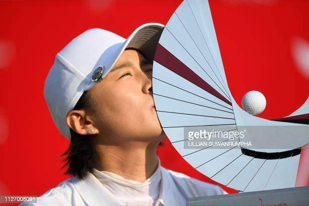Amy Yang of South Korea kisses her trophy after winning the LPGA Thailand golf tournament in Pattaya on February 24 2019