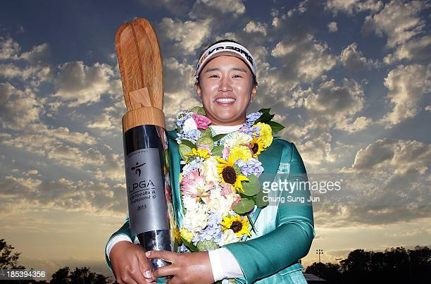 Amy Yang of South Korea lifts the winners trophy during a ceremony following the LPGA KEBHanaBank Championship at Sky 72 Golf Club Ocean Course on...
