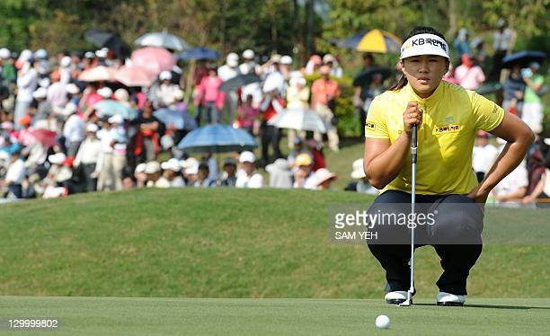 Amy Yang of South Korea lines up a putt on the eigth green during the forth round of the Sunrise LPGA Taiwan Championship golf tournament in Yangmei...