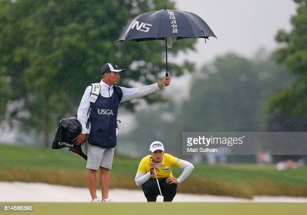 Amy Yang of South Korea lines up a putt with her caddie Greg Johnston on the 15th hole during the second round of the US Women's Open Championship at...