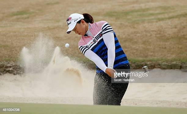 Amy Yang of South Korea plays a bunker shot on the 16th hole during the third round of the 69th US Women's Open at Pinehurst Resort Country Club...