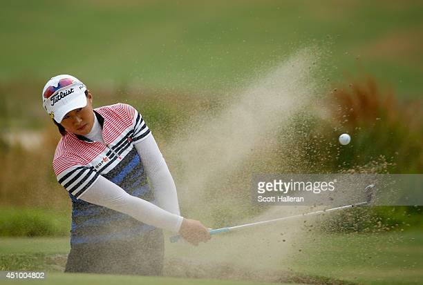 Amy Yang of South Korea plays a bunker shot on the 17th hole during the third round of the 69th US Women's Open at Pinehurst Resort Country Club...