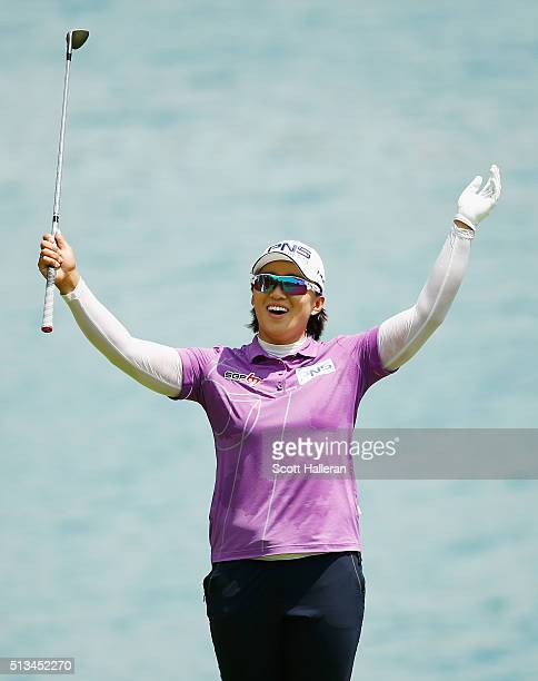 Amy Yang of South Korea reacts to holing a shot on the seventh hole during the first round of the HSBC Women's Champions at Sentosa Golf Club on...