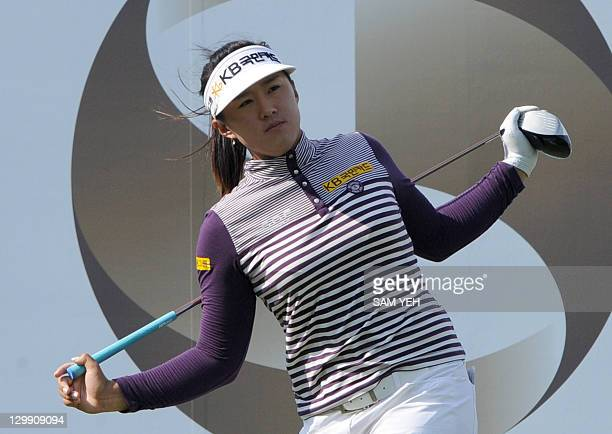 Amy Yang of South Korea stretches before teeing off on 9th hole during the third round of the Sunrise LPGA Taiwan Championship golf tournament in...