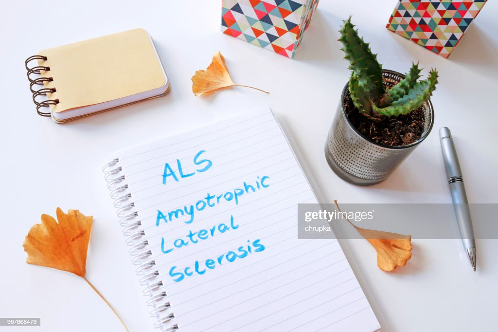 ALS Amyotrophic Lateral Sclerosis written in notebook : Stock Photo