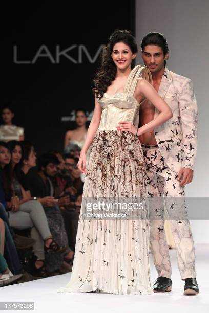 Amyra Dastur Prateik Babbar showcase designs by Ken Ferns on the runway during day 2 of Lakme Fashion Week Winter/Festive 2013 at the Hotel Grand...
