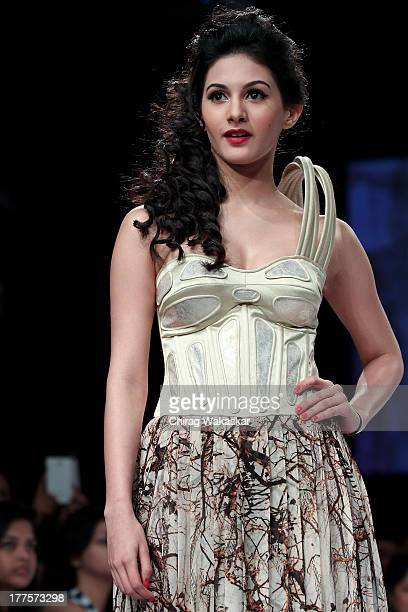 Amyra Dastur showcases designs by Ken Ferns on the runway during day 2 of Lakme Fashion Week Winter/Festive 2013 at the Hotel Grand Hyatt on August...