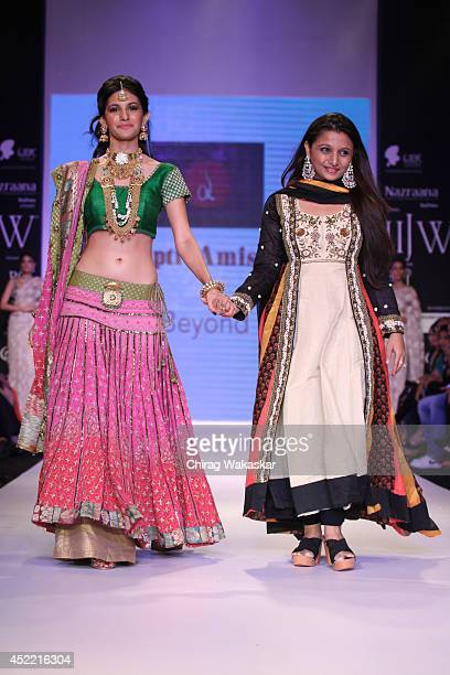 Amyra Dastur walks the runway at the Dipti Amisha show during day 2 of the India International Jewellery Week 2014 at grand Hyatt on July 15 2014 in...