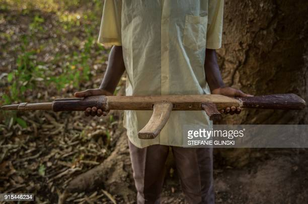 TOPSHOT An 11yearold former child soldier poses with his handmade rifle during a release ceremony in Yambio South Sudan on February 7 2018 More than...