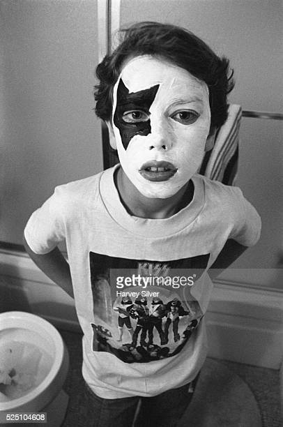 An 11yearold KISS fan poses in his Paul Stanley makeup on Halloween