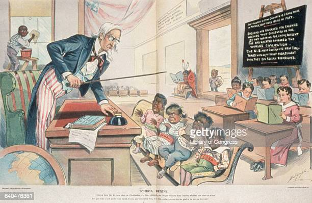 An 1898 Puck magazine cartoon of Uncle Sam lecturing Hawaiian Cuban Puerto Rican and Filipino students on civilization while students representing...