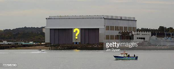 An 18m high question mark built on the construction hall of the historic Cammell Laird shipyard by German artist Hans Peter Kuhn is illuminated at...