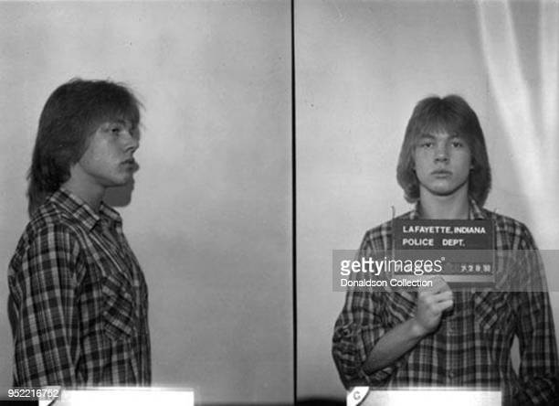 An 18-year-old Axl Rose posed for the above Lafayette, Indiana police mug shot in July 1980.