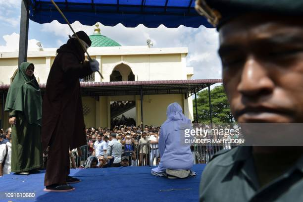 An 18yearold Indonesian woman is caned in public in Banda Aceh on January 31 as punishment for being caught cuddling with her boyfriend Two teenagers...
