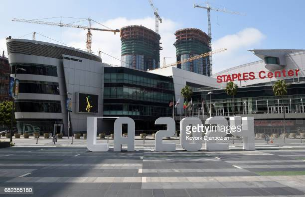 An LA 2024 sign is placed at LA Live in front of Staples Center as the International Olympic Committee Evaluation Commission continues its tour of...