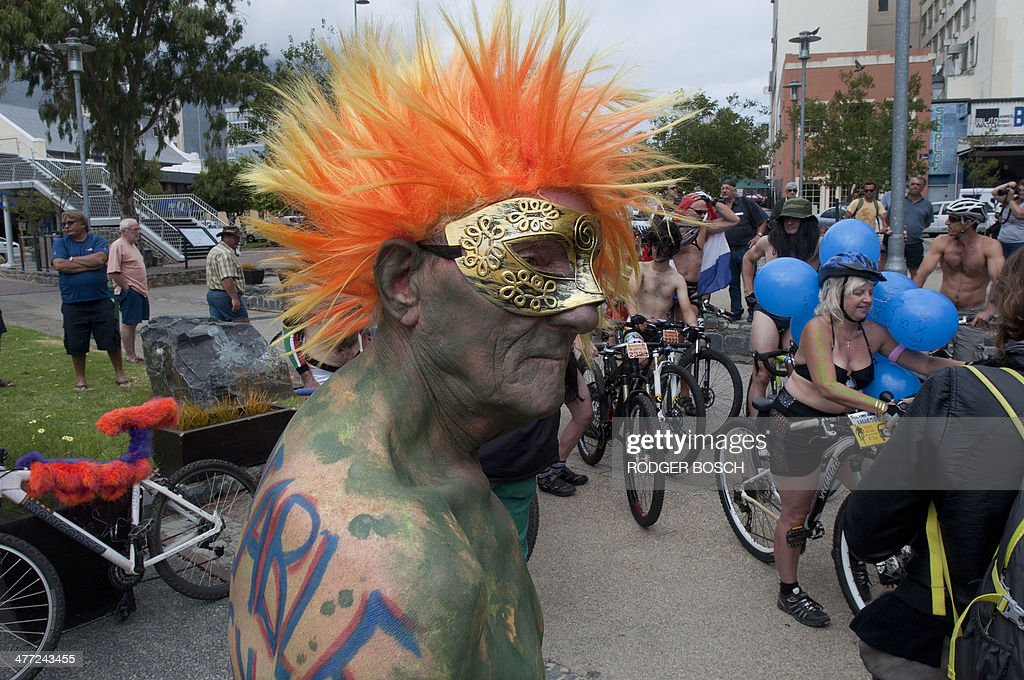 An 81 Year-Old Man In Green Body Paint Gets Ready To Take -7518