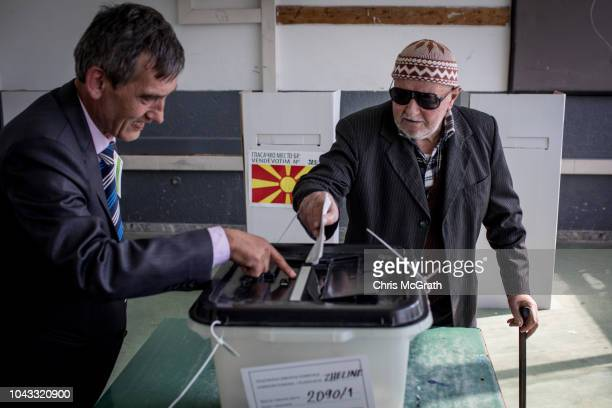 An 86 year old man casts his vote at a polling station on September 30 2018 in Tetovo Macedonia Macedonians all across the country went to the polls...