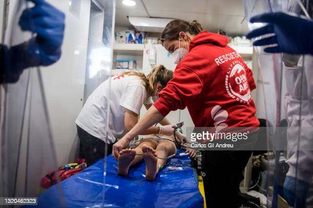 An 8-year-old girl is treated by the medical team of the Spanish NGO Open Arms, after having suffered an epileptic shock and having lost...