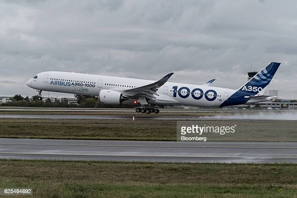 An A3501000 twinjet passenger plane manufactured by Airbus Group SE takes off from the Airbus factory in Toulouse France on Thursday Nov 24 2016 The...