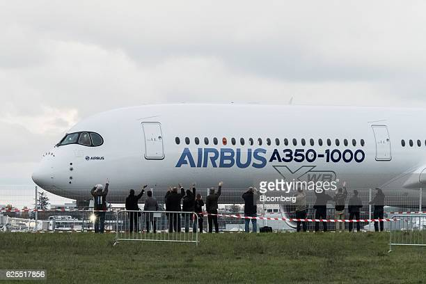 An A3501000 twinjet passenger plane manufactured by Airbus Group SE stands on the tarmac following its first flight at the Airbus factory in Toulouse...
