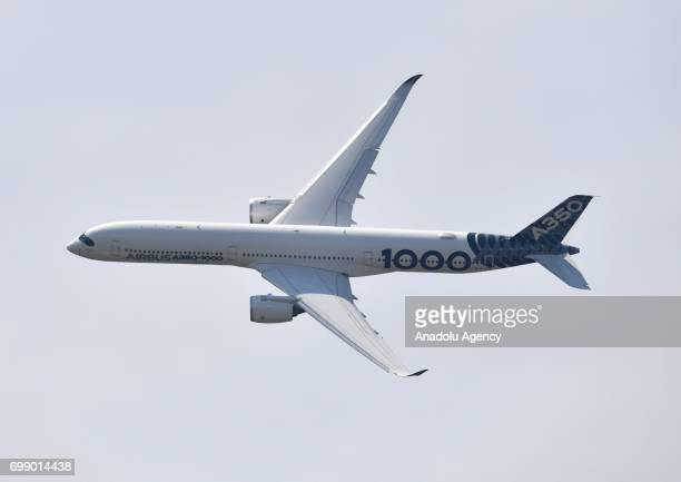 An A3501000 XWB of Airbus flies during the 52nd International Paris Air Show at the Le Bourget Airport near Paris France on June 20 2017