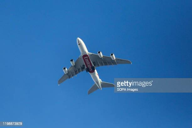 An A380 Emirates Airline with its landing gear down is seen over Westminster, London.