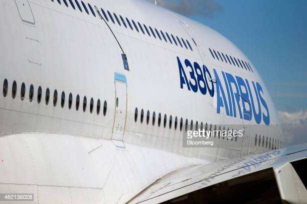 An A380 logo sits on the fuselage of an Airbus A380 aircraft produced by Airbus Group NV as it stands on display on the first day of the Farnborough...
