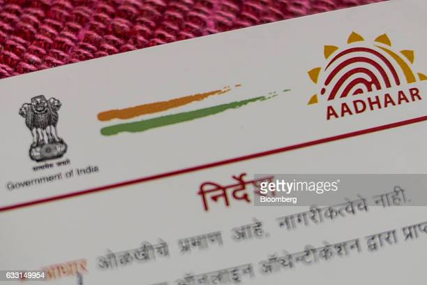 An Aadhaar biometric identity card issued by the Unique Identification Authority of India is arranged for a photograph in Mumbai India on Saturday...
