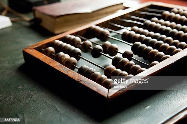 An abacus laying on a green table