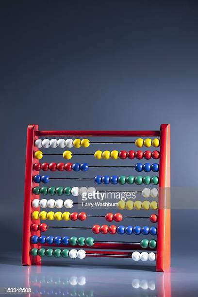 an abacus with multi colored wooden beads - perlenschnur stock-fotos und bilder