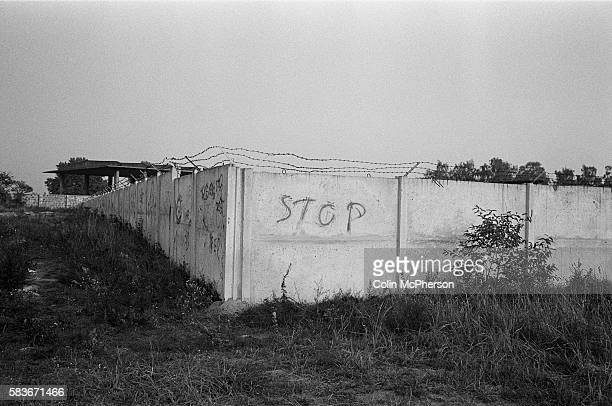 An abandon former East German military barracks near a section of the course of the former Berlin Wall, Oranienburg, Berlin. The Berlin Wall was a...