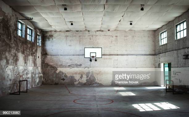 an abandoned basketball court. - sports court stock pictures, royalty-free photos & images